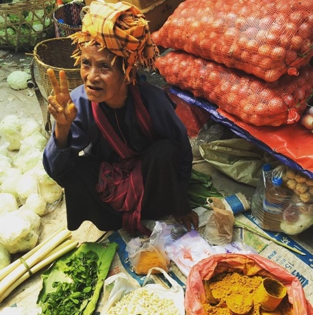 Woman selling spices in food market Myanmar